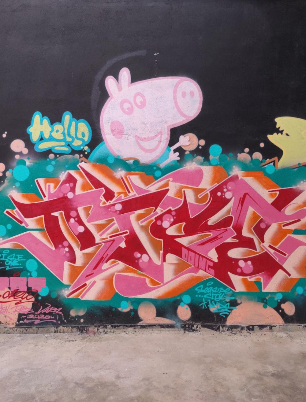 green and pink graffiti art