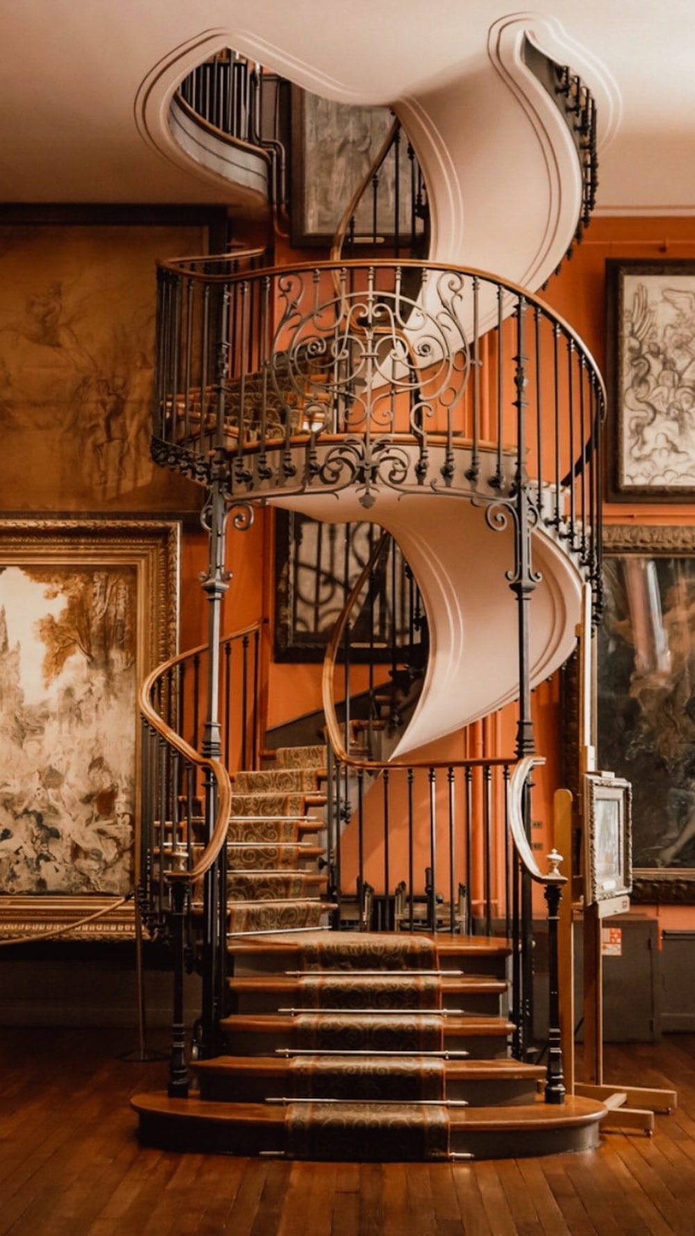brown spiral staircase with brown steel railings