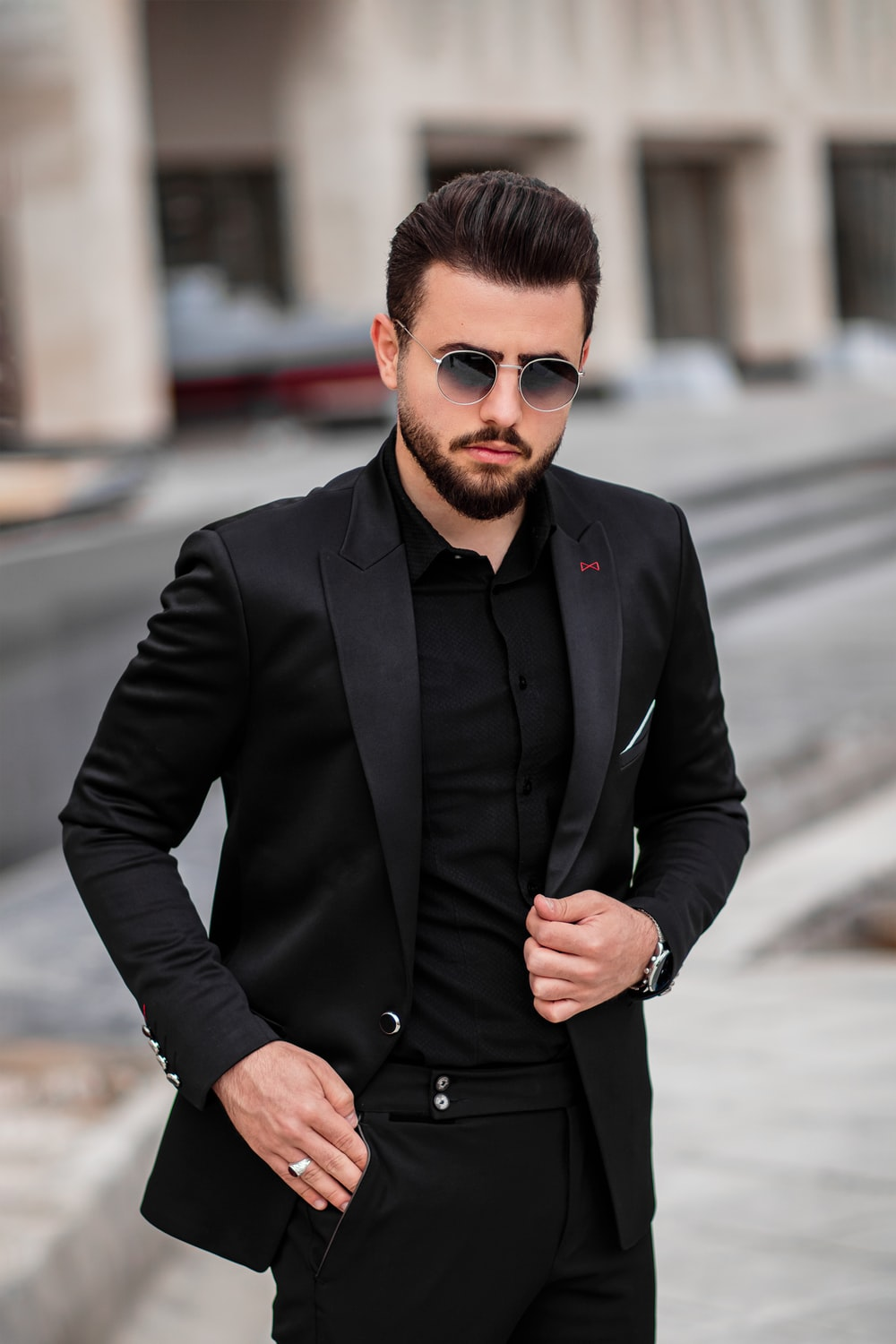 man in black suit jacket and black sunglasses