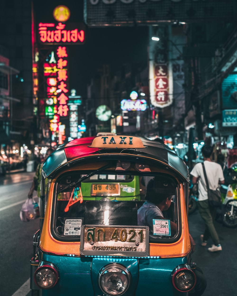 yellow taxi cab on the street during night time