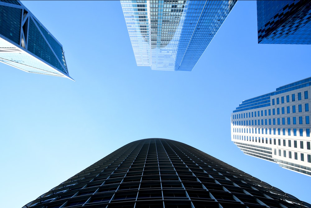 low angle photography of high rise buildings under blue sky during daytime