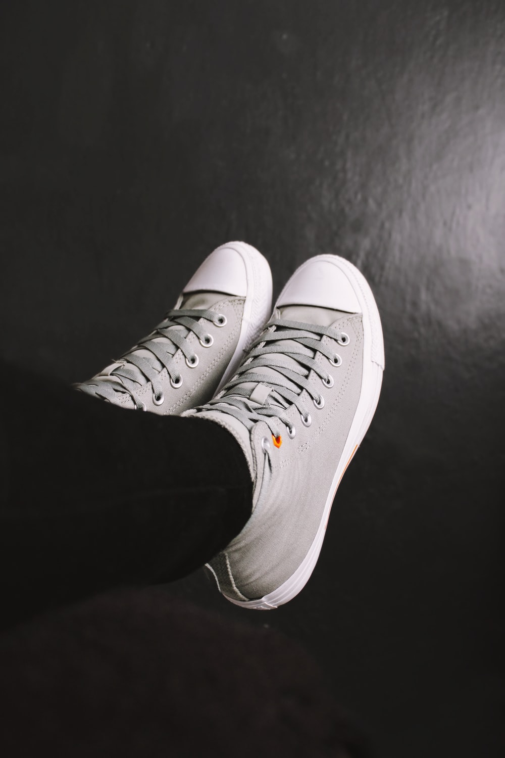 person wearing white nike sneakers