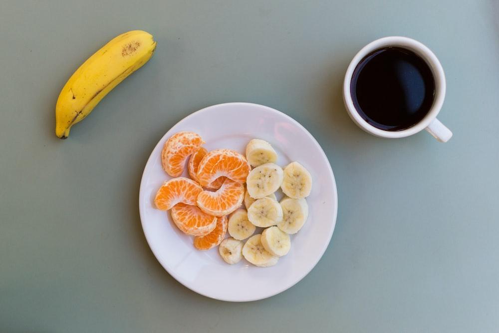 yellow banana fruit on white ceramic plate