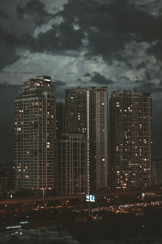 city buildings under dark clouds