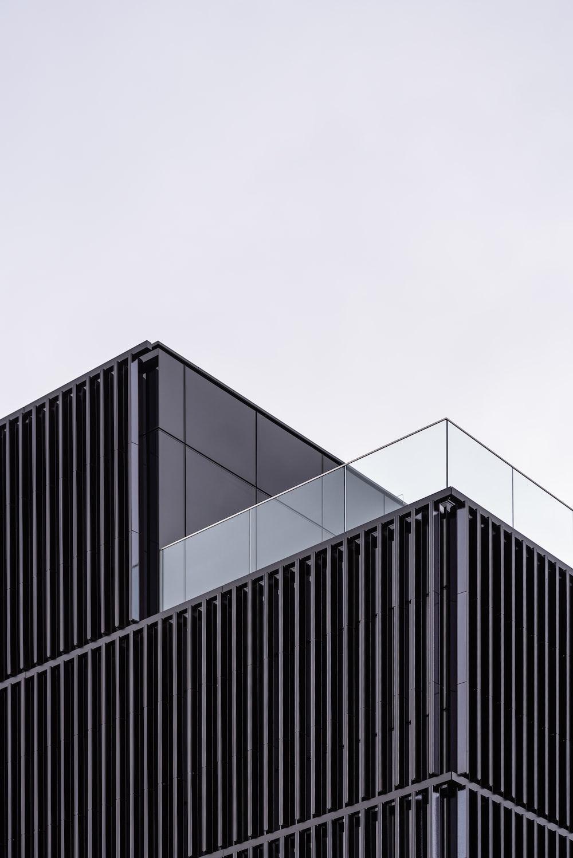 black steel gate under white sky during daytime