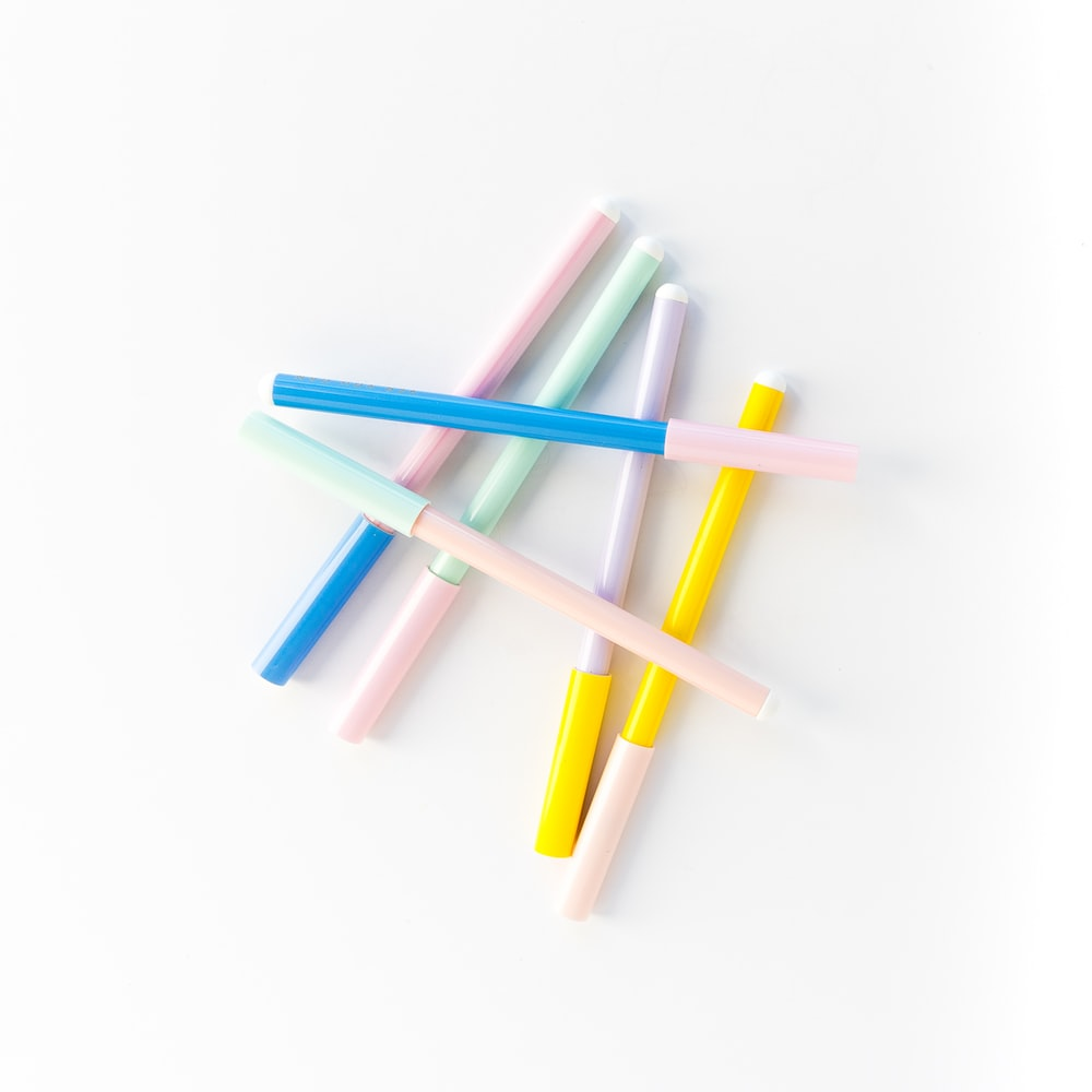 pink blue and green color pencils