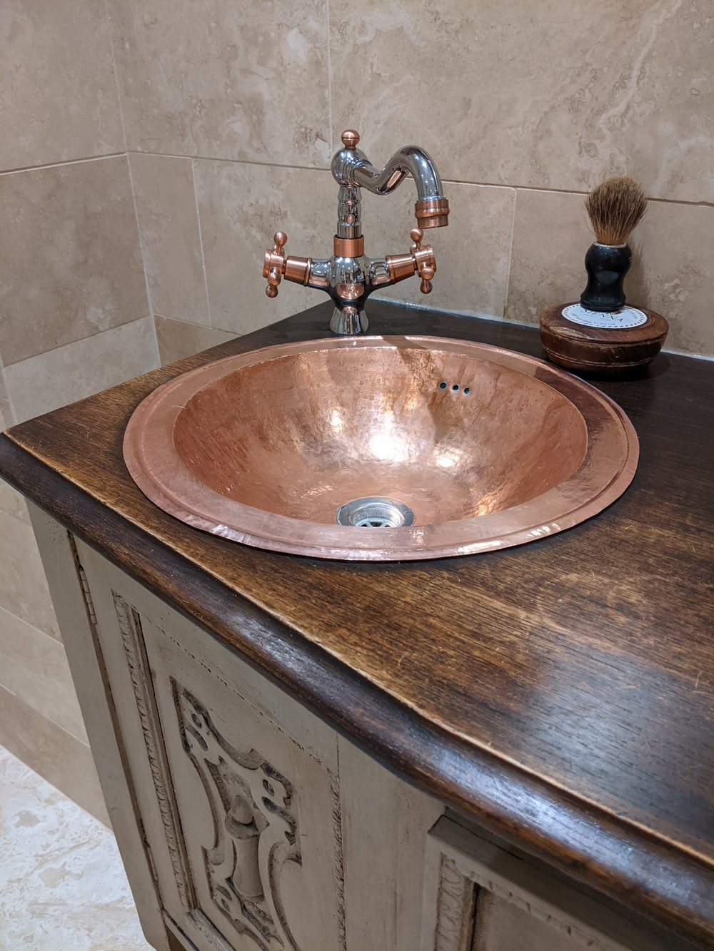 brown ceramic sink with stainless steel faucet