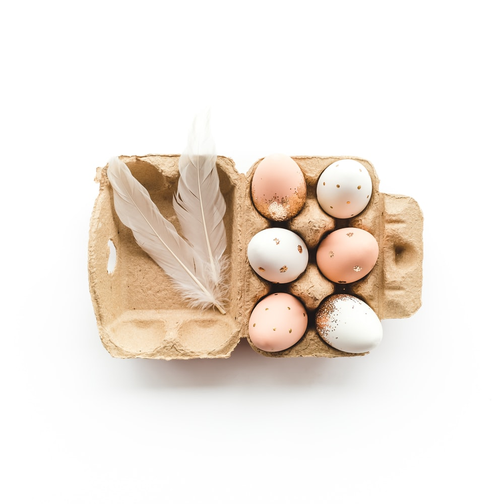 white eggs in brown paper bag