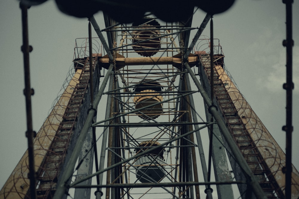 low angle photography of brown metal tower