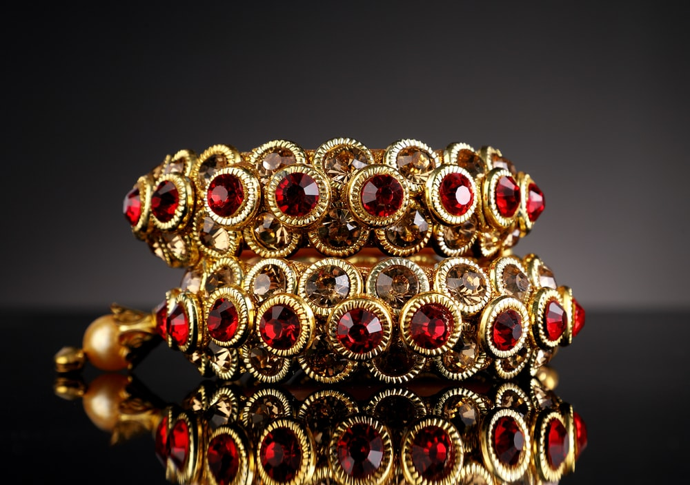 gold and red beaded accessory