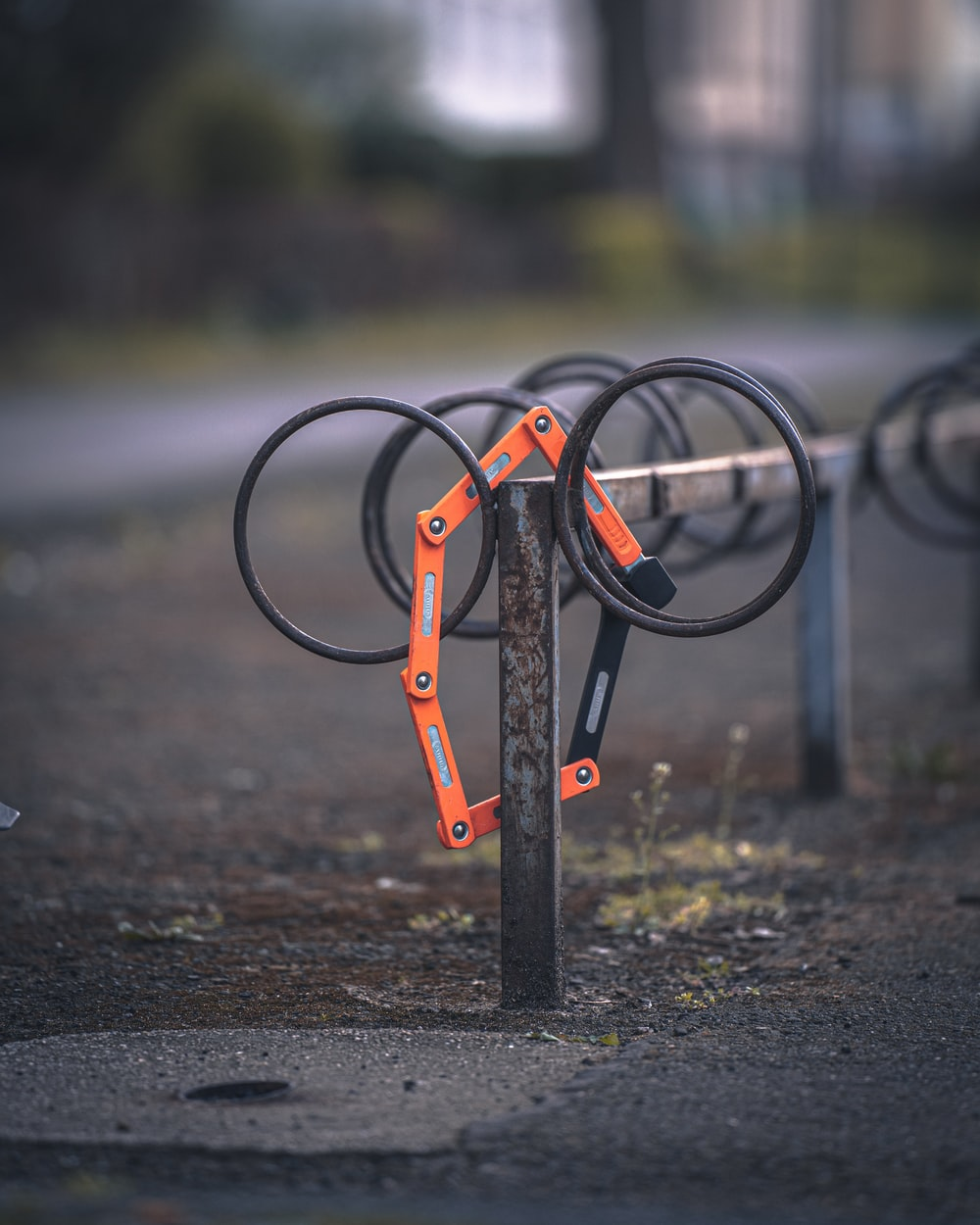 black and orange metal frame on brown soil