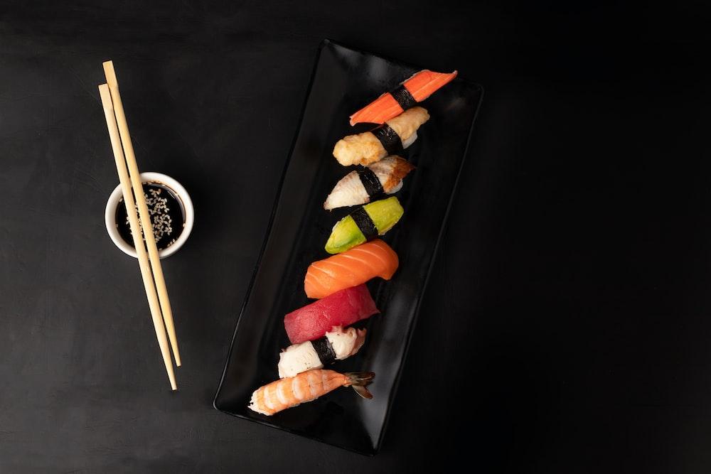 sushi on black square plate