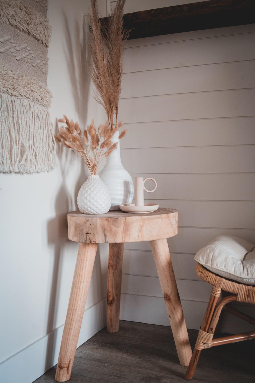 white ceramic vase on brown wooden seat