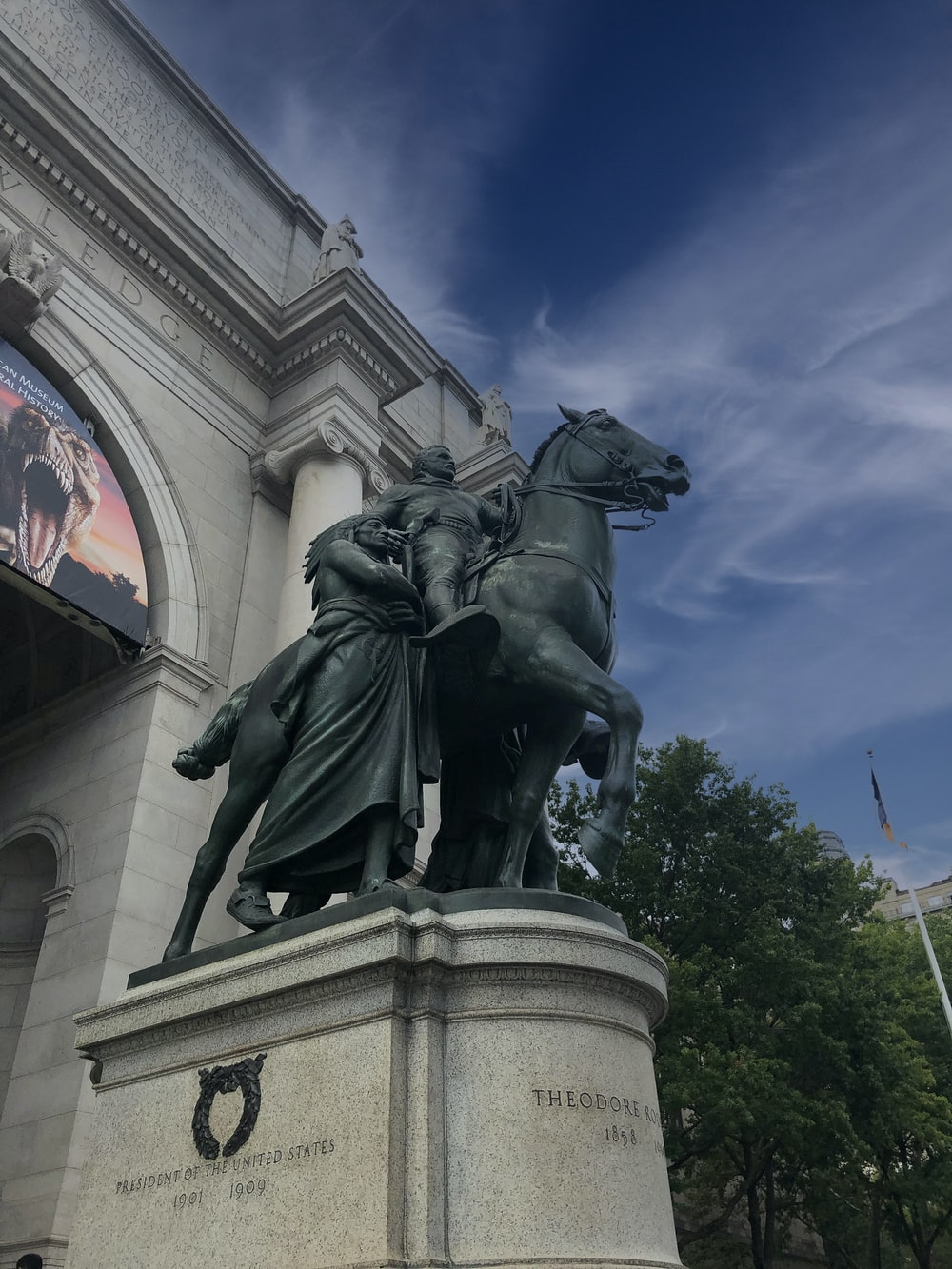 man riding horse statue under blue sky during daytime