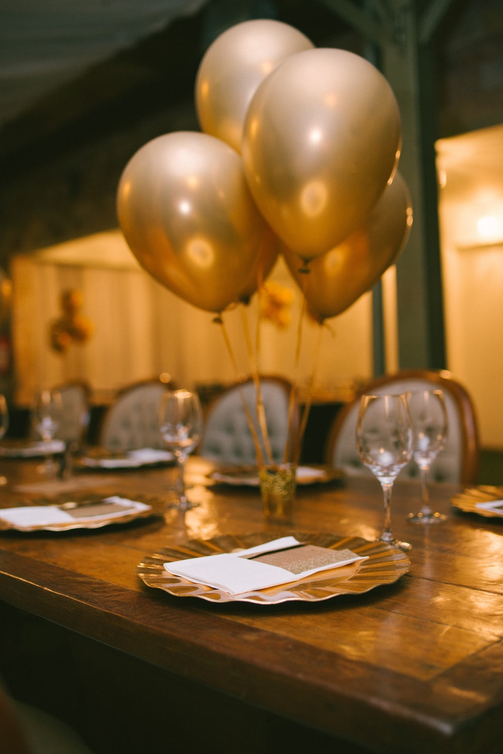 gold balloons on brown wooden table