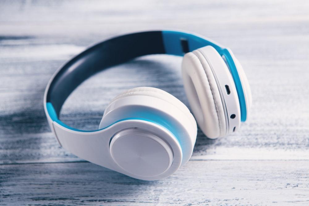 white and orange cordless headphones