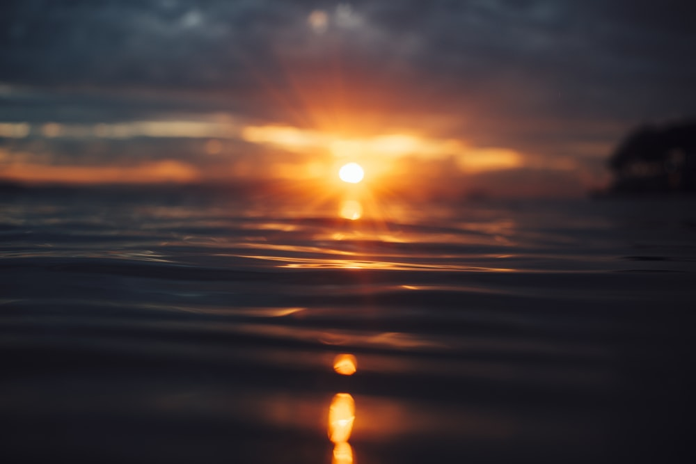 sun setting over the horizon