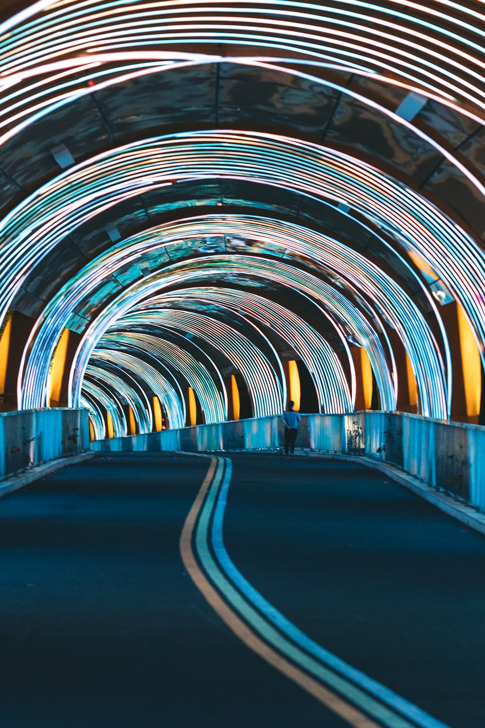 blue and yellow tunnel during daytime