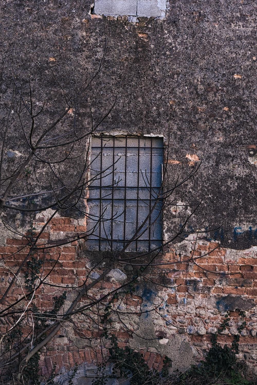 black metal frame on brown brick wall