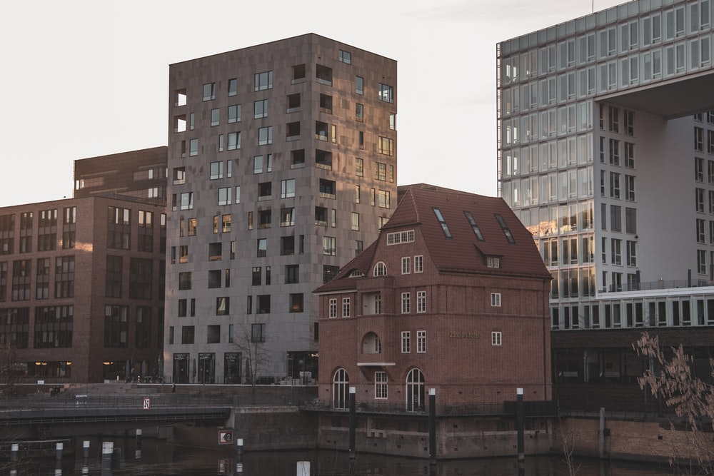 brown concrete building near body of water during daytime
