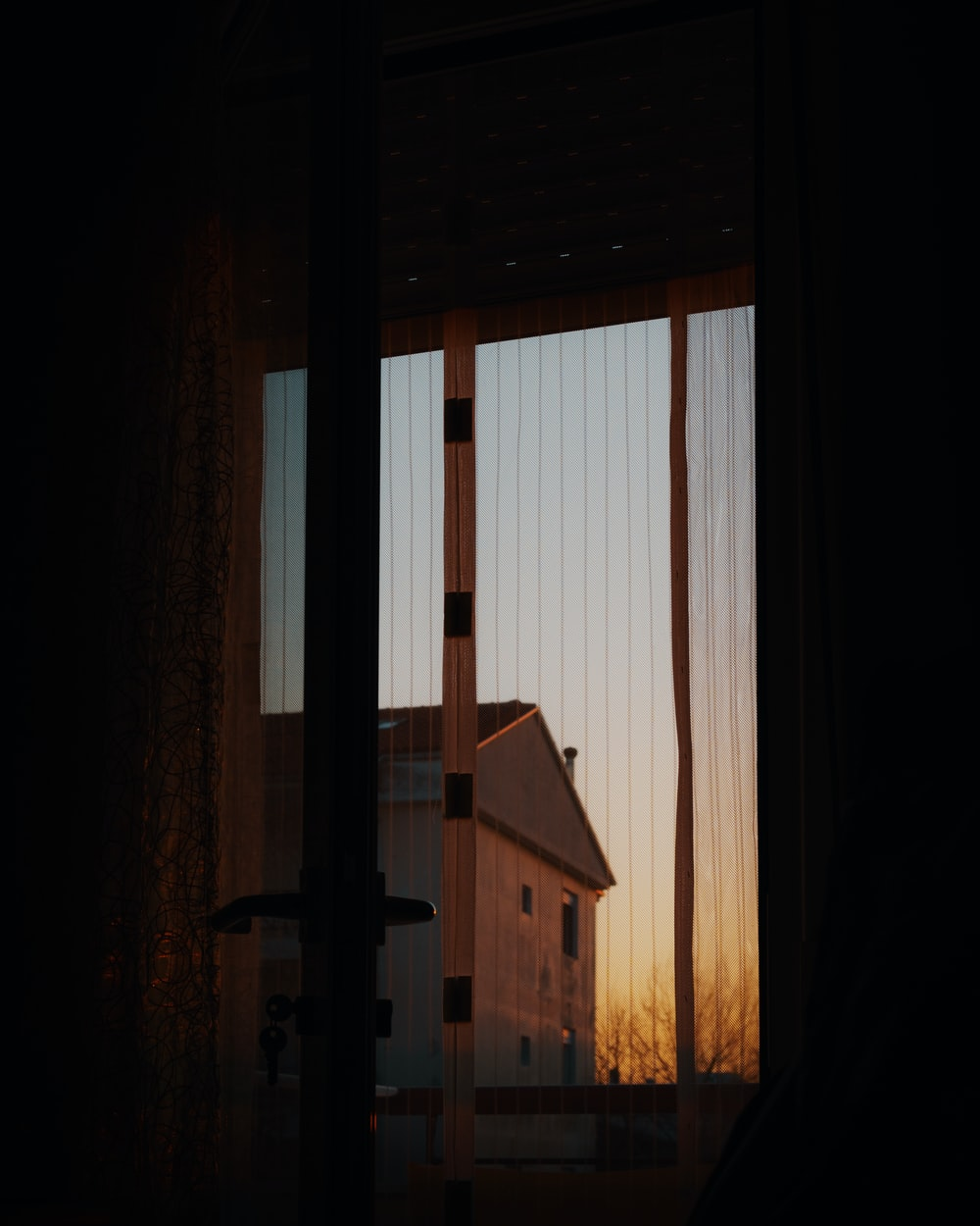 brown wooden house in front of brown wooden window