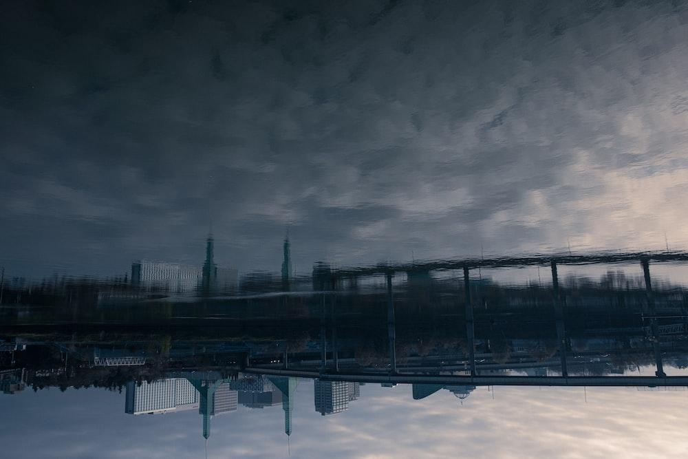 black metal bridge under gray clouds