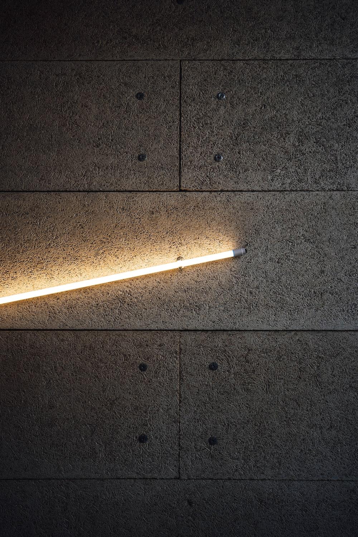 white and brown cigarette stick on black floor tiles