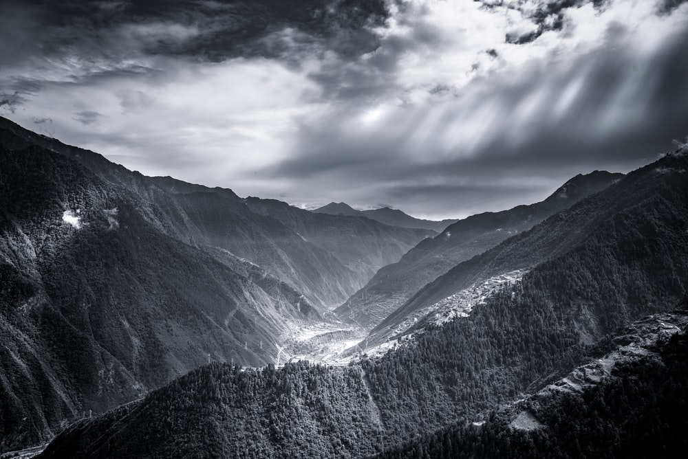 gray and green mountains under gray clouds