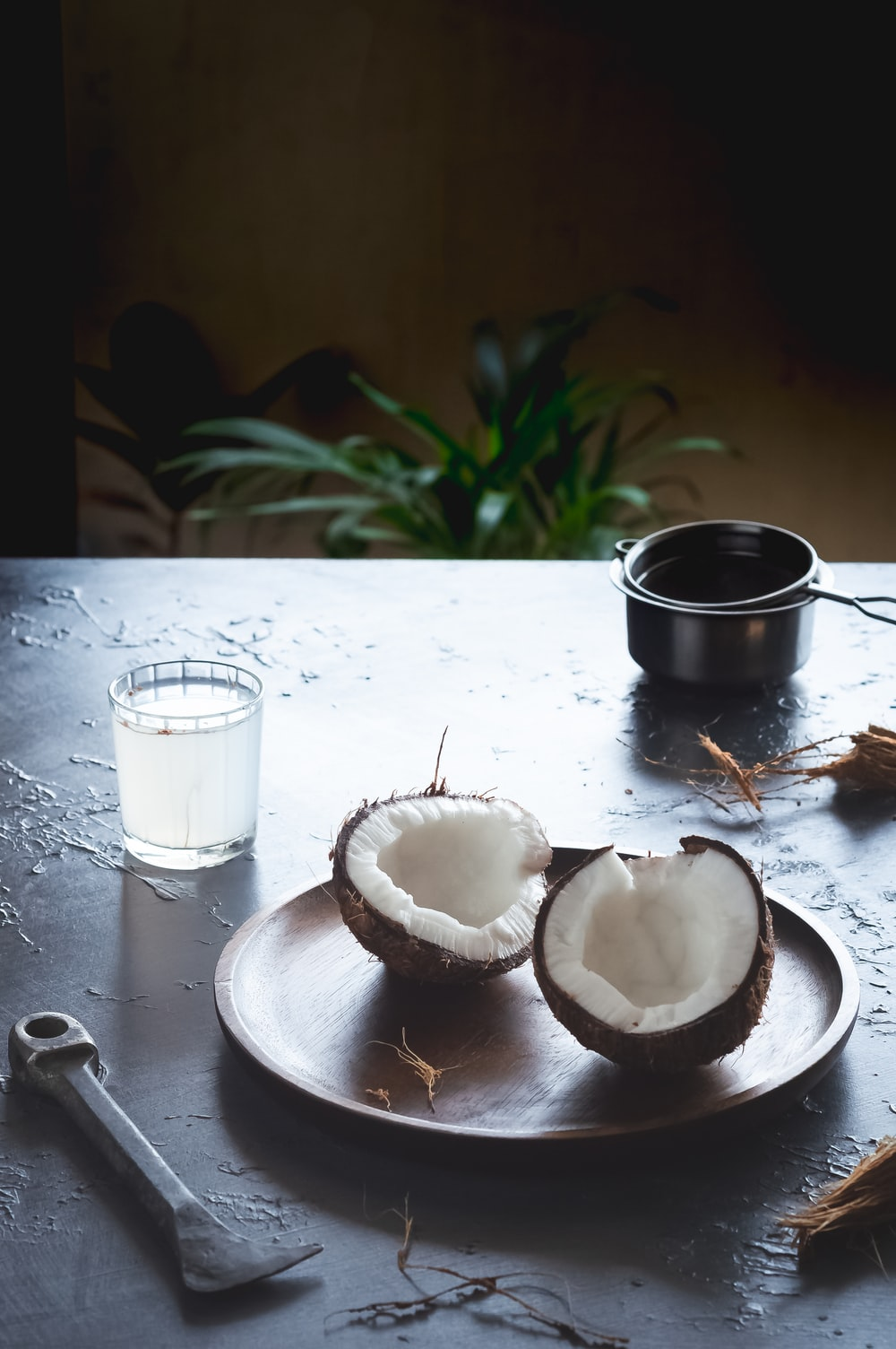 sliced apple beside black ceramic mug on white wooden table