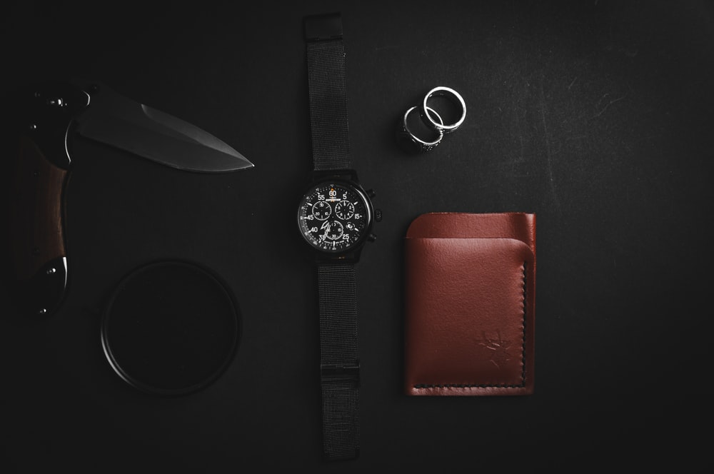 black leather strap silver round analog watch and brown leather bifold wallet