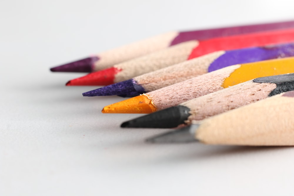 red yellow and green color pencil