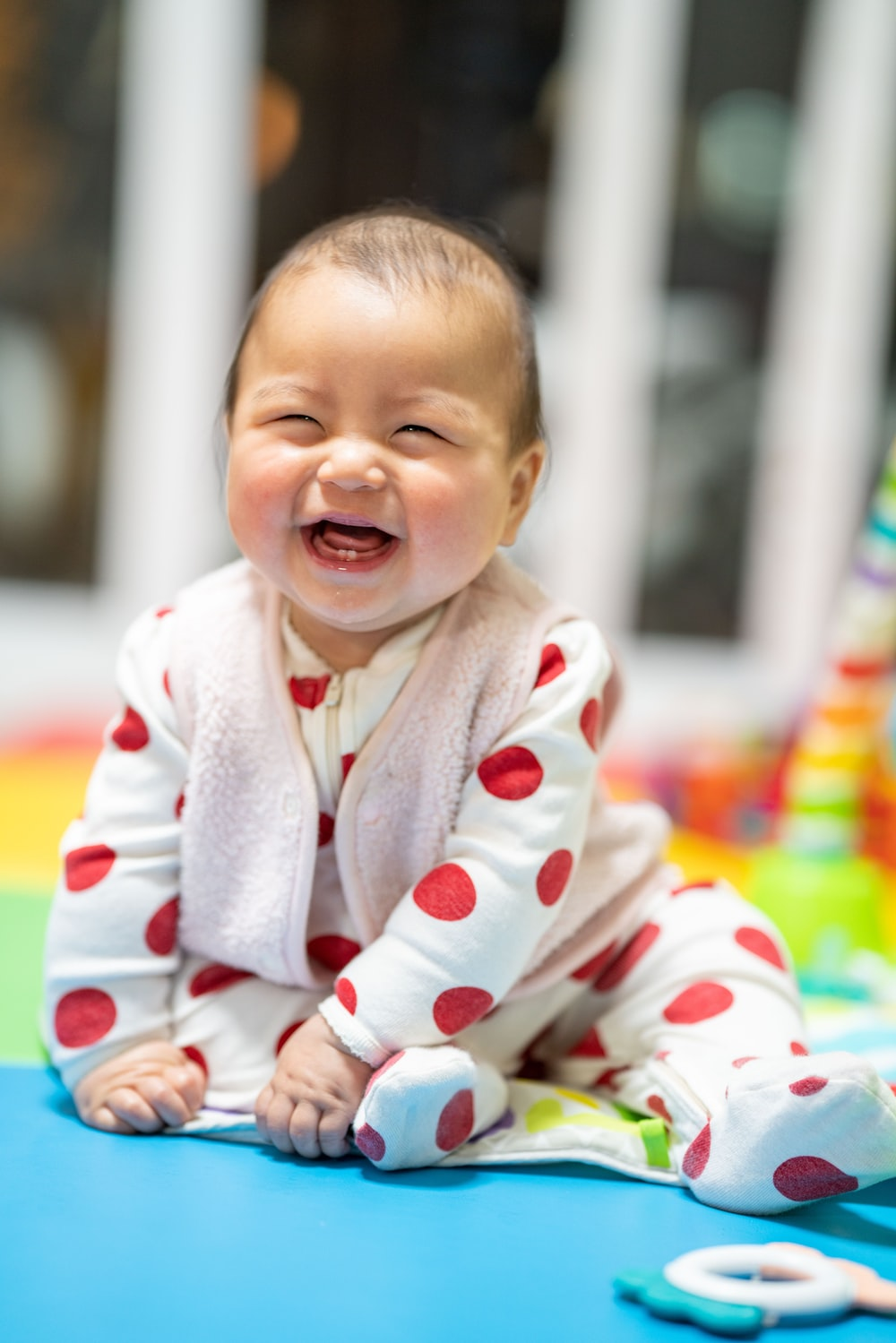 baby in white and red heart print onesie
