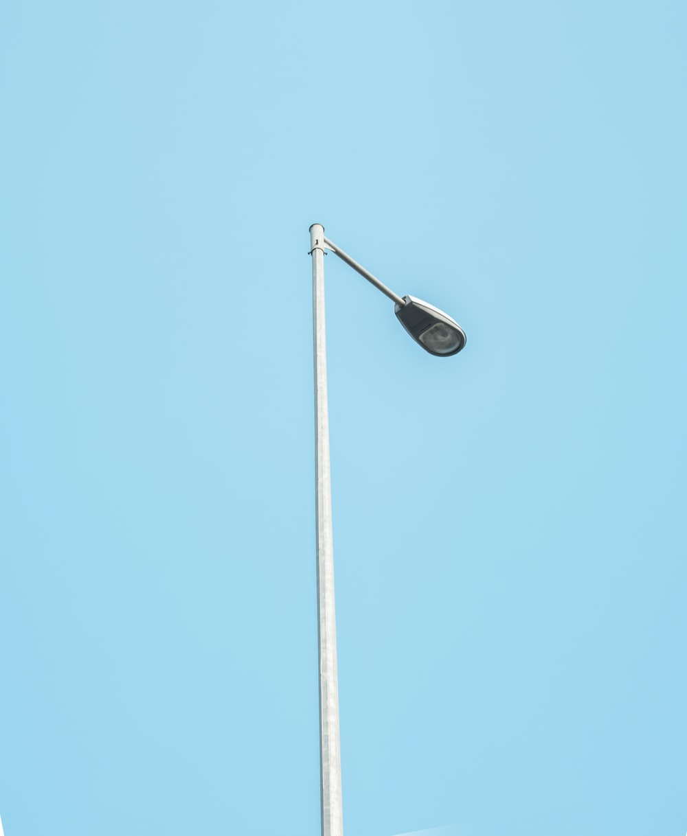 black street light under blue sky during daytime