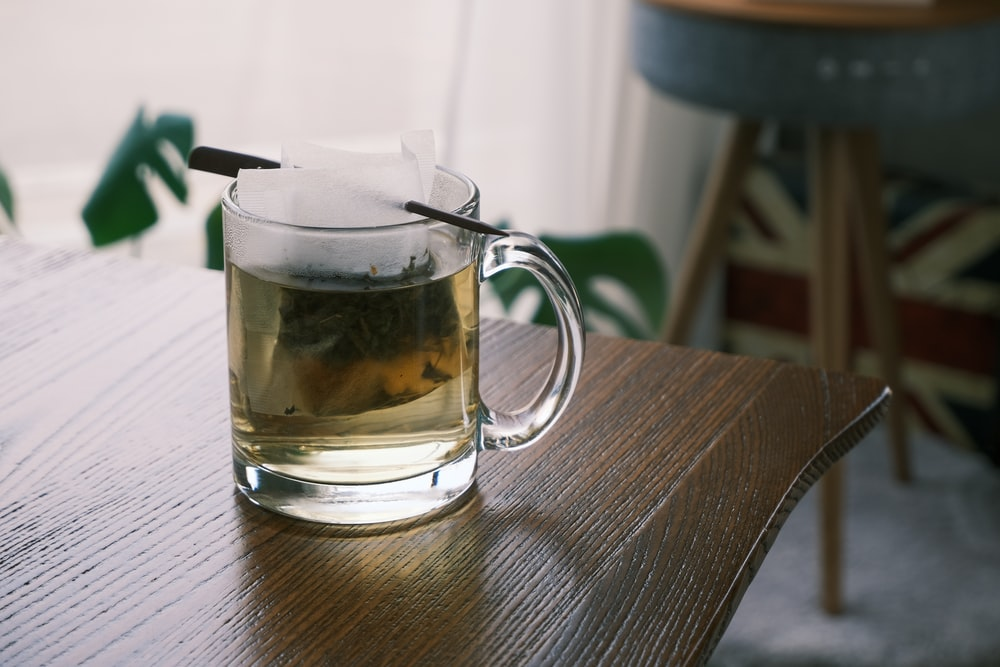clear glass mug on brown wooden table