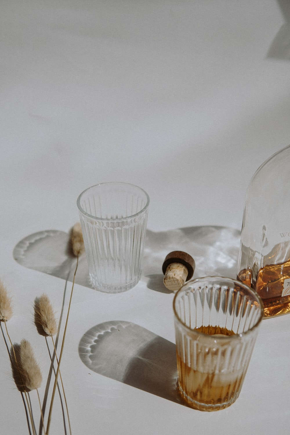 clear drinking glass on white table cloth