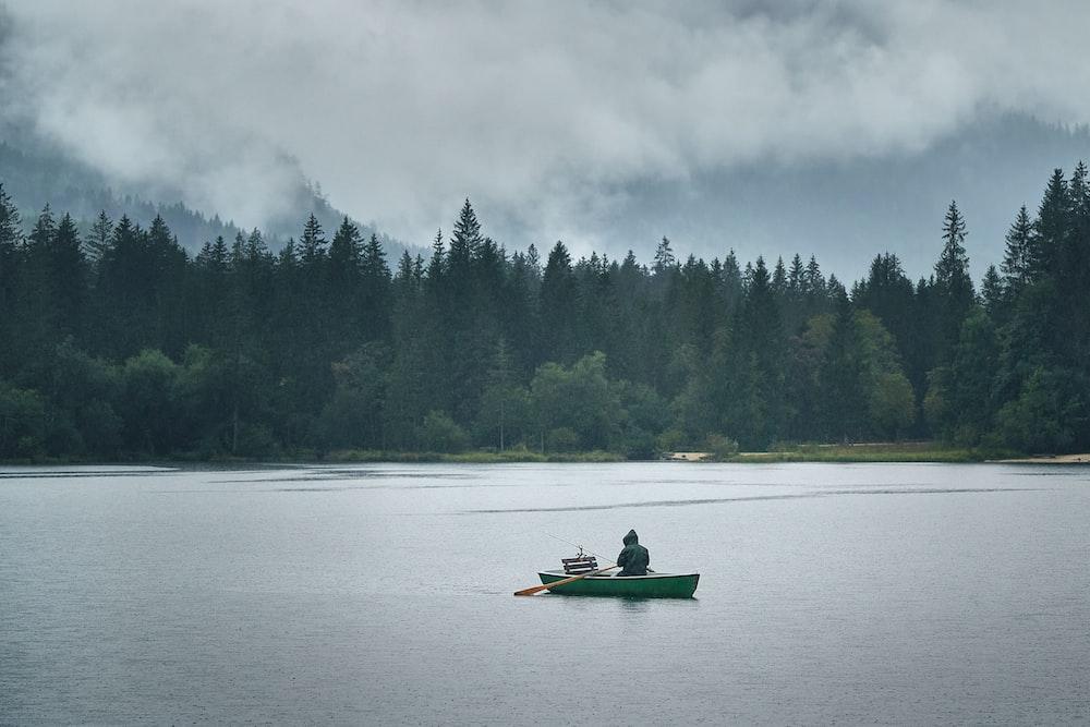 2 people riding on kayak on lake during daytime