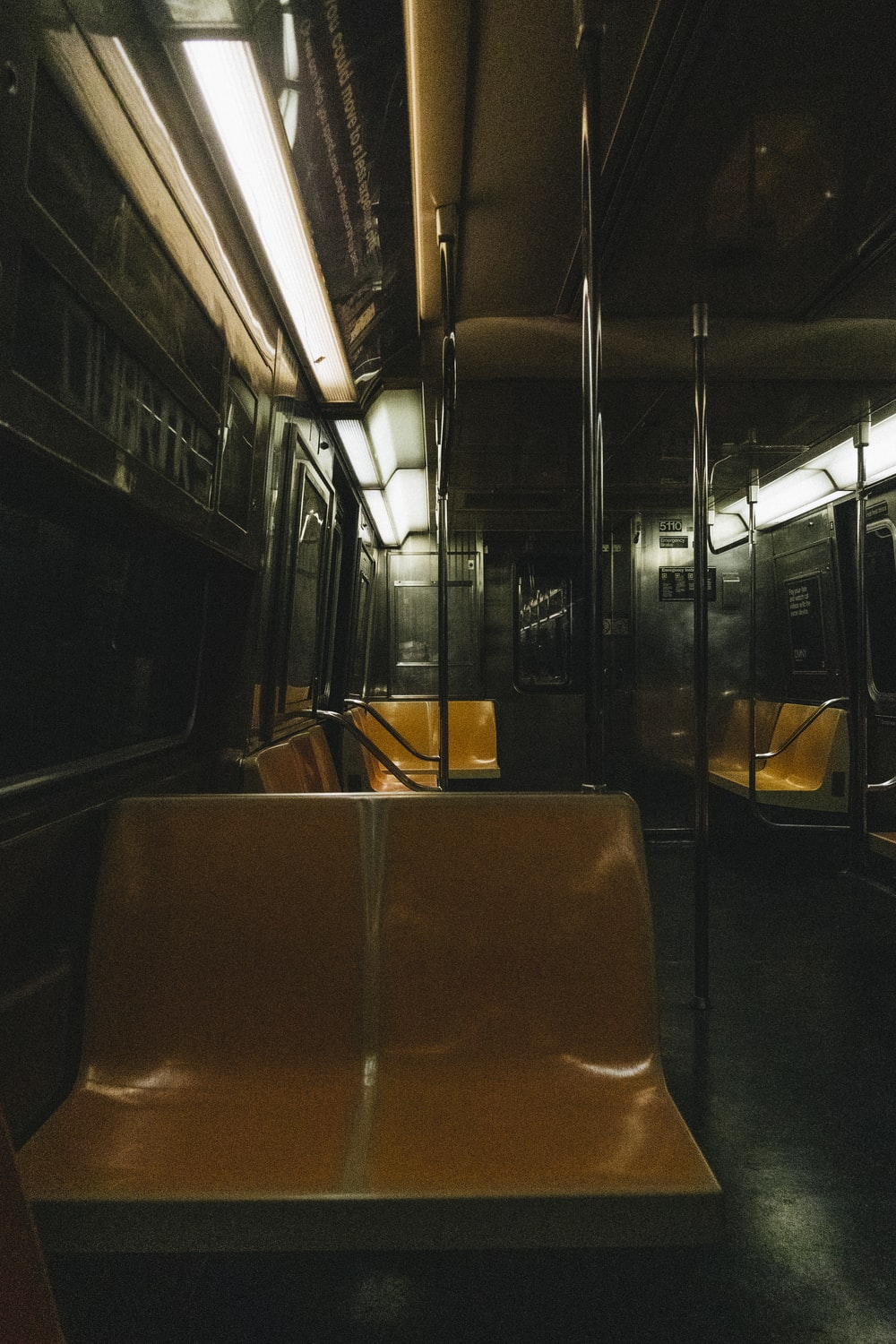 brown leather bus seat during night time