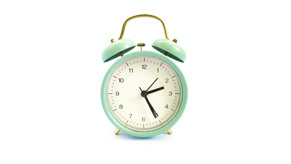 green and white alarm clock