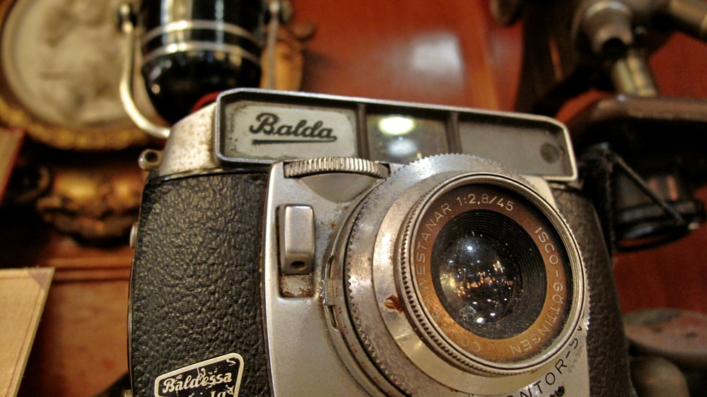 black and silver nikon camera