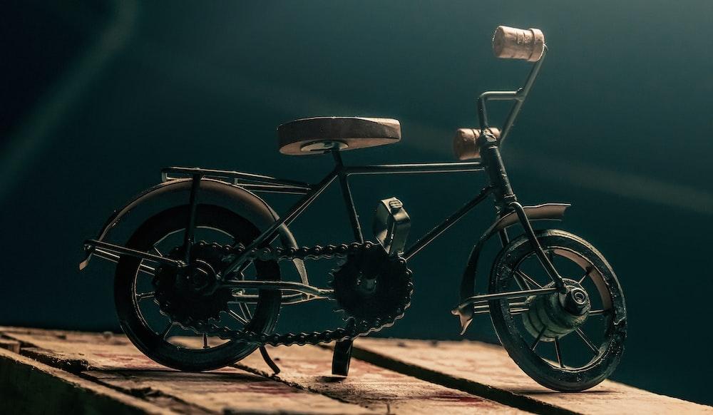 black city bike on brown sand during daytime