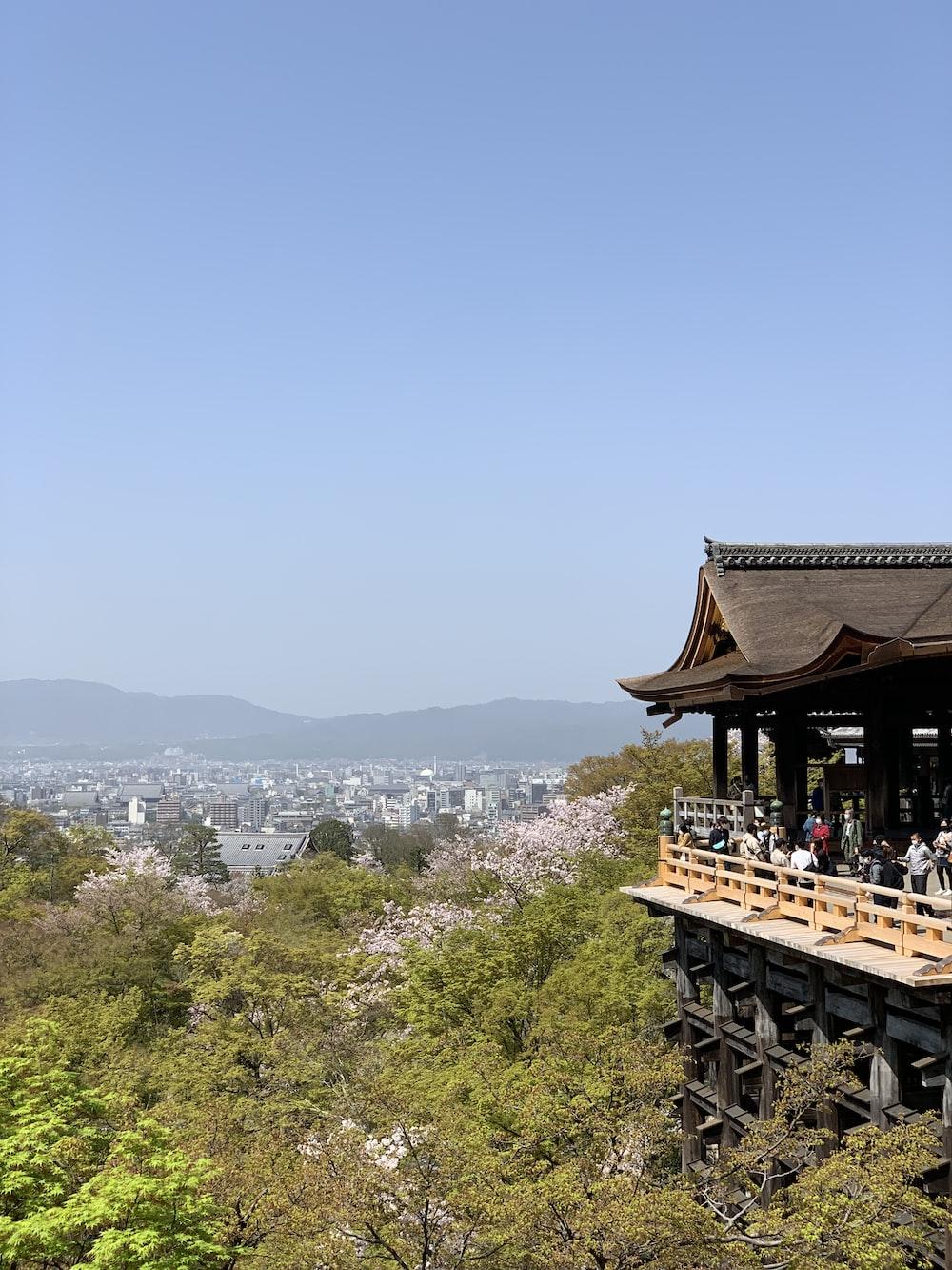 brown wooden gazebo on top of mountain during daytime