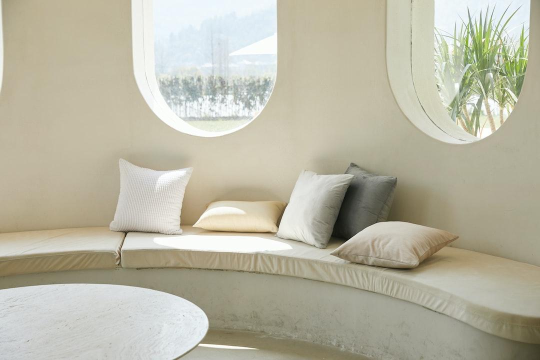 white sofa near round table