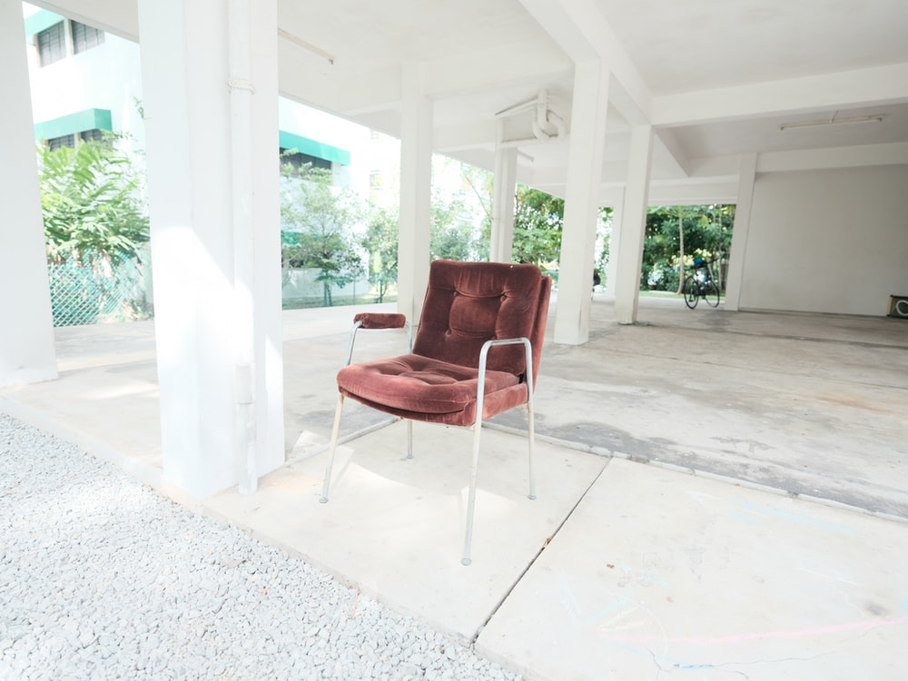 red and silver armchair on white concrete floor