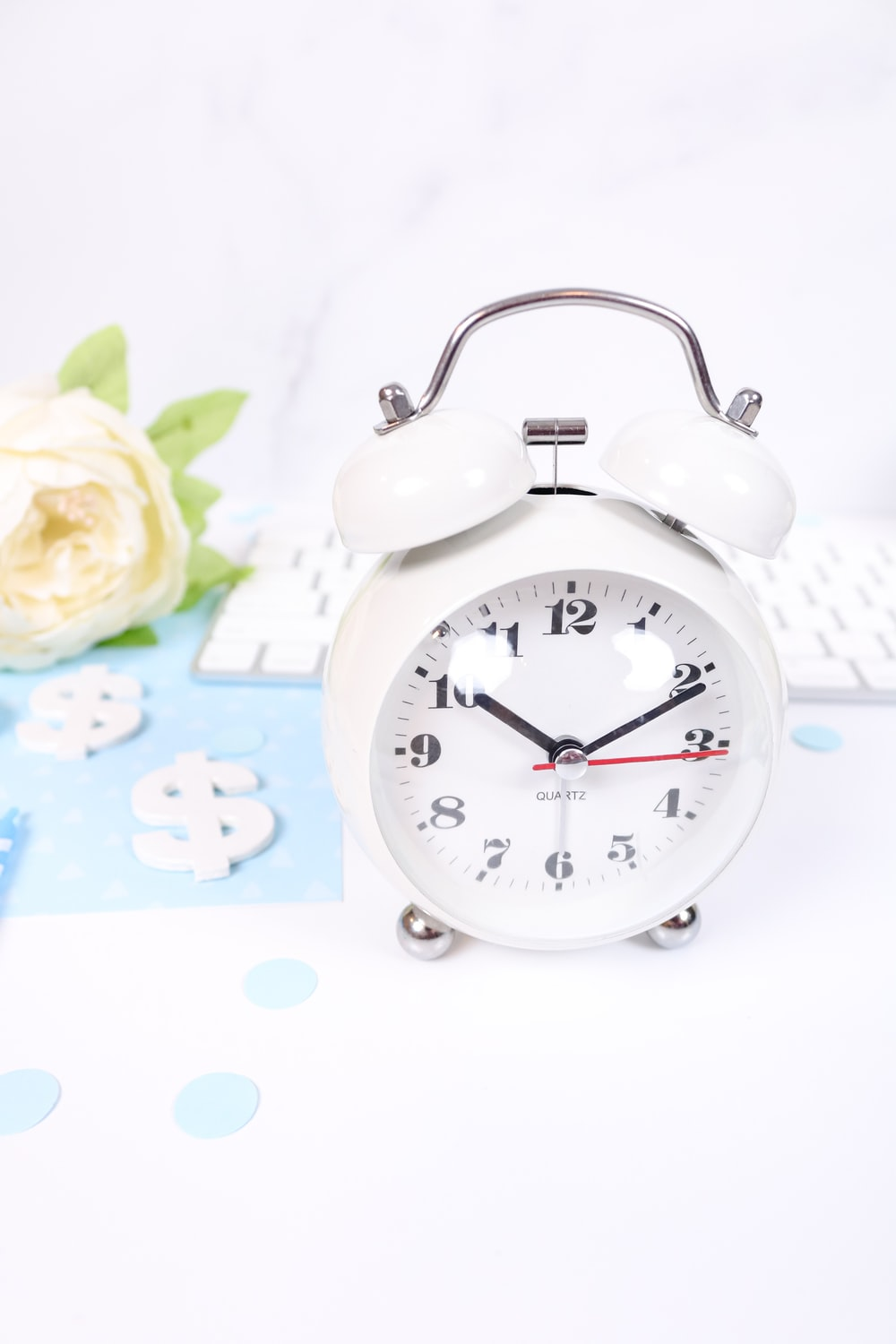white and pink alarm clock