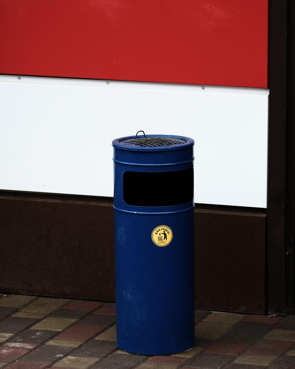 blue and black trash bin