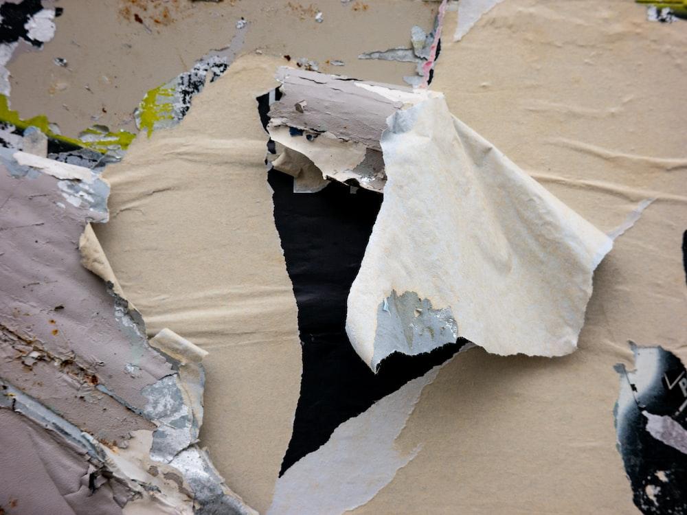 white textile on brown sand