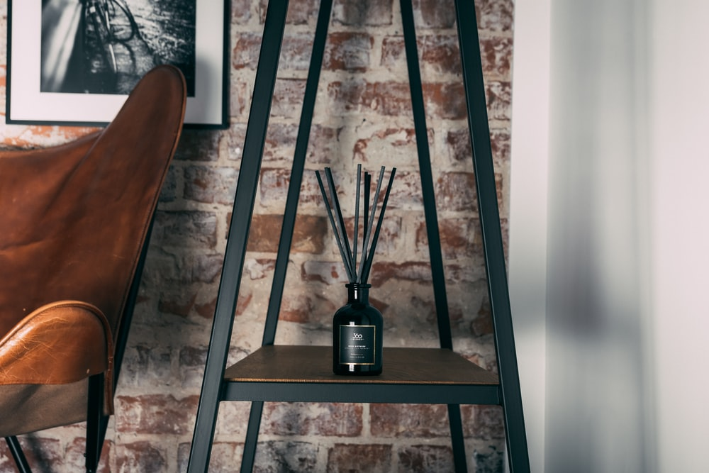 black glass bottle on brown wooden table