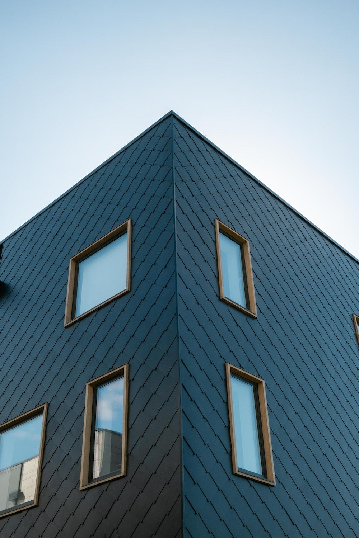 black concrete building with glass windows