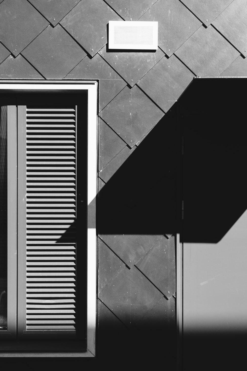black and white photo of a window