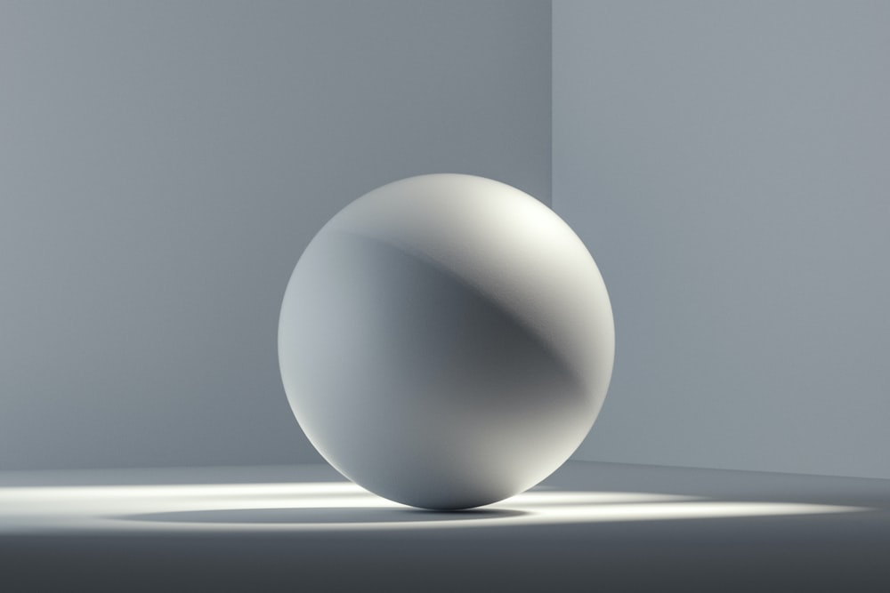 white egg on white surface